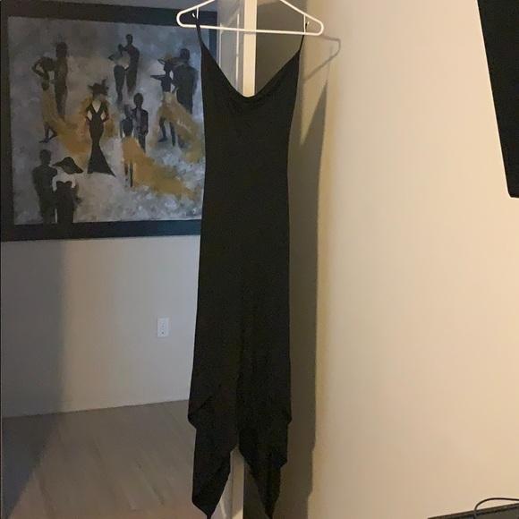 bebe Dresses & Skirts - Asymmetrical backless black Bebe dress